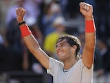 Spain's Rafael Nadal celebrates after defeating Switzerland's Roger Federer in the final of the Rome Masters on May 19, 2013