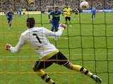 Hoffenheim's Sejad Salihovic scores the winner from the penalty spot against Dortmund on May 18, 2013