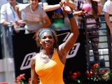 Serena Williams celebrates after defeating Simona Halep in the Rome Masters on May 18, 2013