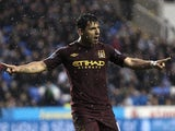 City striker Sergio Aguero celebrates a goal against Reading on May 14, 2013