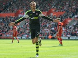 Stoke City's Peter Crouch celebrates scoring against Southampton on May 19, 2013