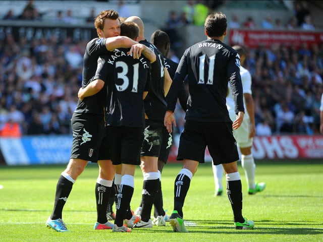 Fulham's Alexander Kacaniklic is congratulated after scoring against Swansea on May 19, 2013