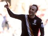 Fulham's Dimitar Berbatov celebrates scoring against Swansea on May 19, 2013
