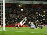 Arsenal's Theo Walcott watches the ball go in over Wigan's Joel on May 14, 2013