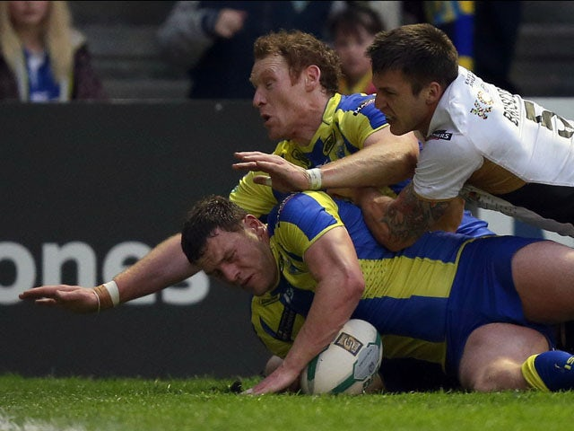 Warrington Wolves Simon Grix scores a try against Hull FC during the Super League on May 17, 2013