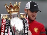 Wayne Rooney poses with the Premier League trophy