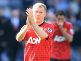 Manchester United's Paul Scholes applauds the fans after his final appearance for the club on May 19, 2013