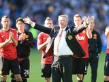 Manchester United manager Sir Alex Ferguson acknowledges the fans after his final game in charge of the club on May 19, 2013