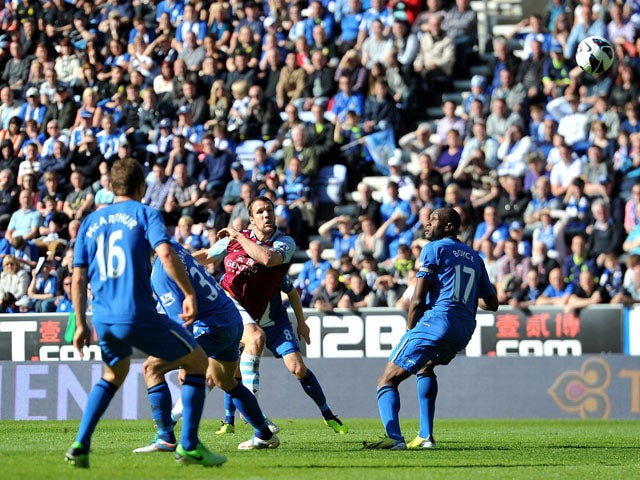 Aston Villa's Ron Vlaar scores his teams second goal in the Premier League match against Wigan on May 19, 2013