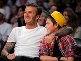 Brooklyn Beckham watches a NBA basketball game with his dad David Beckham on March 4, 2012