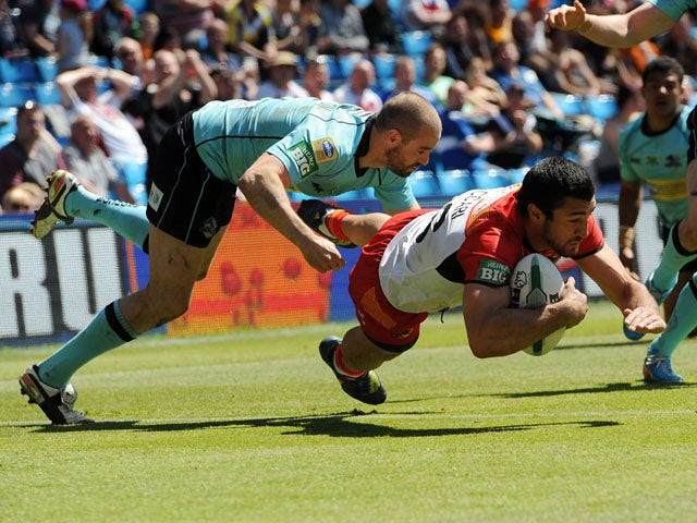 Catalan Dragons' Frederic Vaccari dives over to score a try during the Super League match against London Broncos on May 25, 2013