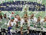 Celtic players celebrate winning the cup over Hibs on May 26, 2013
