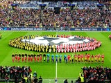 Borussia Dortmund and Bayern Munich players line up prior to kick-off on May 25, 2013