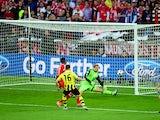 Borussia Dortmund's Jakub Blaszczykowski has his shot saved by Bayern Munich goalkeeper Manuel Neuer during the Champions League final on May 25, 2013