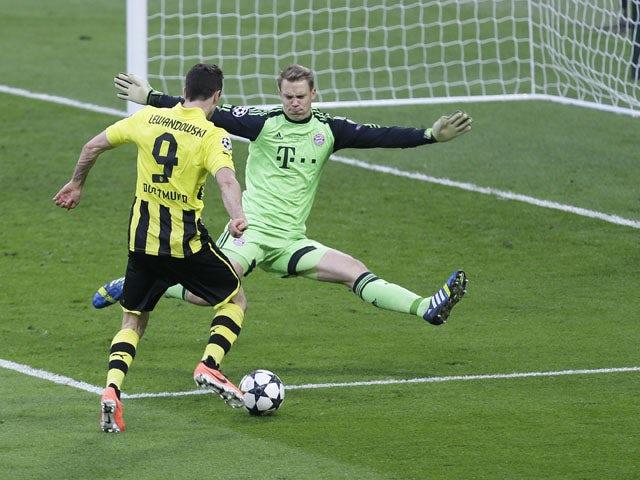 Bayern goalkeeper Manuel Neuer blocks a shot by Dortmund's Robert Lewandowski during the Champions League final on May 25, 2013