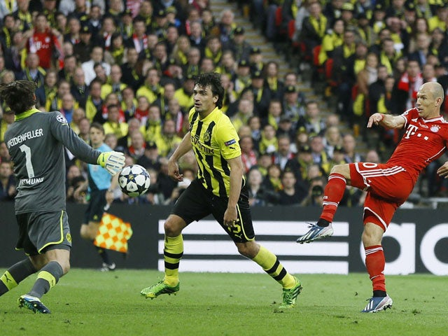 Dortmund goalkeeper Roman Weidenfeller vies for the ball with Bayern's Arjen Robben during the Champions League Final on May 25, 2013
