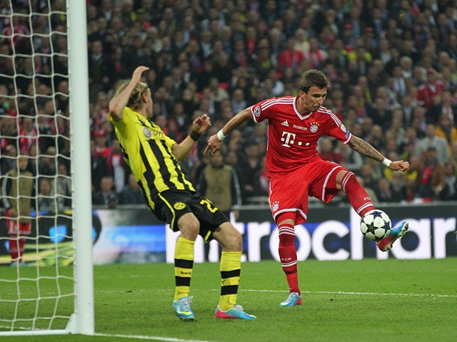 Bayern Munich's Mario Mandzukic scores the first goal of the Champions League Final on May 25, 2013