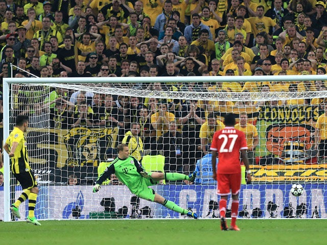 Borussia Dortmund's Ilkay Gundogan scores from the penalty spot during the Champions League Final on May 25, 2013