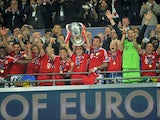 Bayern Munich players celebrate as they lift the UEFA Champions League trophy on May 25, 2013