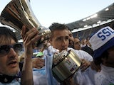 Lazio's Miroslav Klose celebrates winning the Coppa Italia against Roma on May 26, 2013