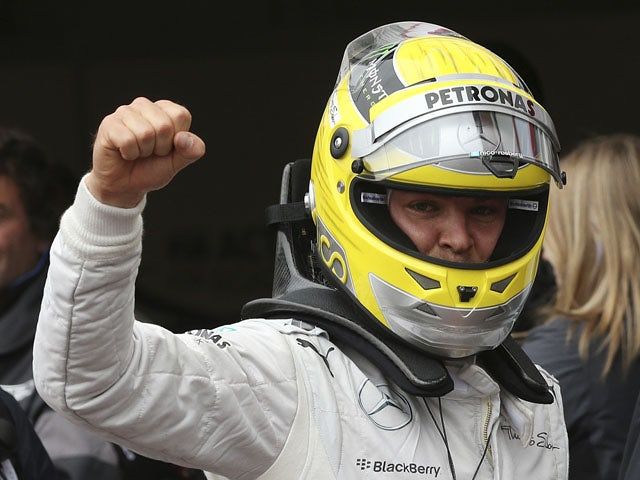 Mercedes driver Nico Rosberg celebrates setting the fastest time during the qualifying for the Monaco Grand Prix on May 25, 2013