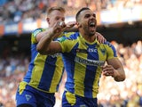 Warrington Wolves' Ryan Atkins celebrates with Chris Riley after scoring a try during the Super League against St Helens on May 25, 2013