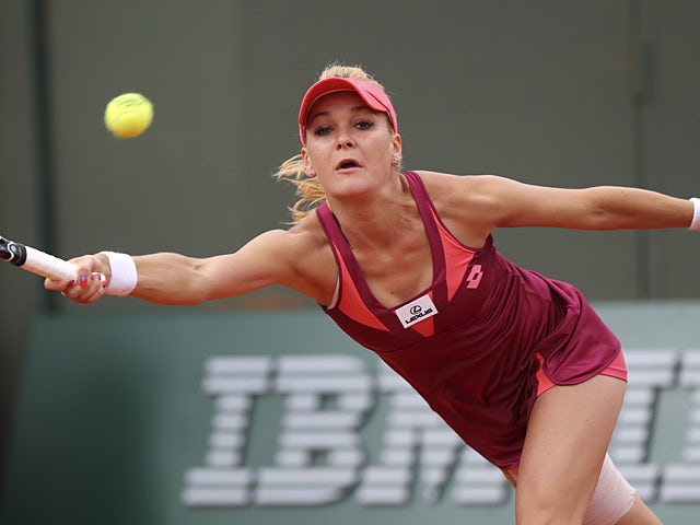 Agnieszka Radwanska returns the ball to Mallory Burdette during their second round match of the French Open on May 29, 2013