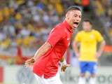 England's Alex Oxlade-Chamberlain celebrates after scoring the equaliser against Brazil during a friendly match on June 2, 2013