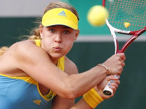 Angelique Kerber returns the ball to Varvara Lepchenko during their third round match of the French Open on May 31, 2013