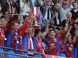 Crystal Palace players celebrate with the Football League Championship play off final trophy on May 27, 2013