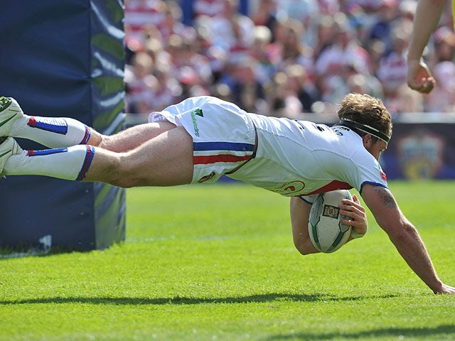 Wakefield Wildcats' Danny Kirmond scores a try against Wigan Warriors on June 2, 2013