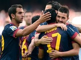 Barcelona's David Villa is congratulated by team mates after scoring the opening goal against Malaga on June 1, 2013