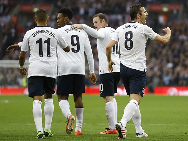 England's Frank Lampard celebrates his equaliser with team mates in the match against Ireland on May 29, 2013