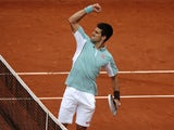 Serbia's Novak Djokovic reacts as he defeats Belgium's David Goffin during their first round match of the French Open tennis tournament on May 28, 2013