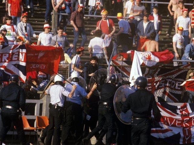 Police and Liverpool fans clash at Heysel.