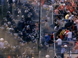 Liverpool fans clash with the Belgian police at Heysel Stadium.