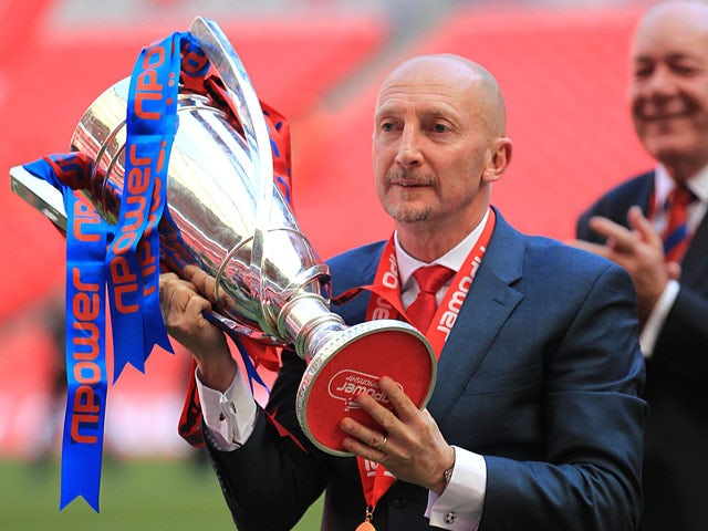 Crystal Palace manager Ian Holloway celebrates with the npower Football League Championship play off final trophy on May 27, 2013