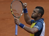 Jo-Wilfried Tsonga celebrates after defeating Jarkko Nieminen during their second round match of the French Open on May 29, 2013