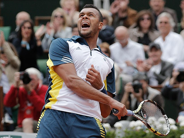 Jo-Wilfried Tsonga celebrates after defeating Viktor Troicki during their fourth round match of the French Open on June 2, 2013