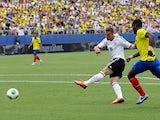 Germany's Lukas Podolski scores his team's third goal against Ecuador on May 29, 2013