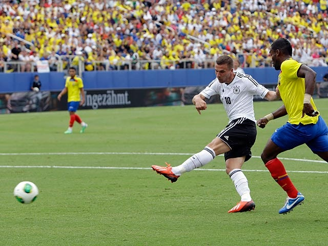 Germany's Lukas Podolski scores his team's third goal against Ecuador on May 29, 2013