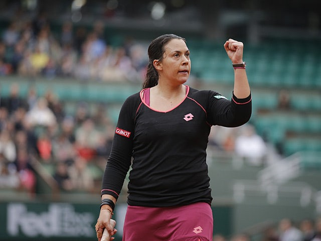 Marion Bartoli celebrates after defeating Mariana Duque-Marino during their second round match of the French Open on May 31, 2013