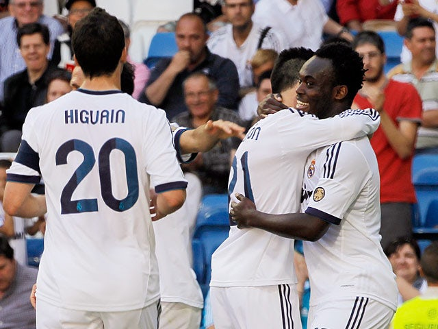 Real's Michael Essien is congratulated by team mates after scoring his team's second against Osasuna on June 1, 2013