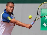 Mikhail Youzhny returns the ball to Janko Tipsarevic during their third round match of the French Open on June 1, 2013