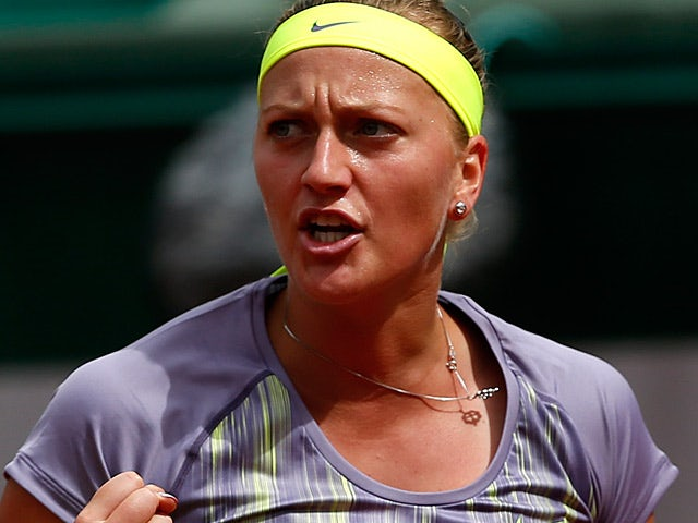 Petra Kvitova celebrates after defeating Aravane Rezai during their first round match of the French Open on May 29, 2013