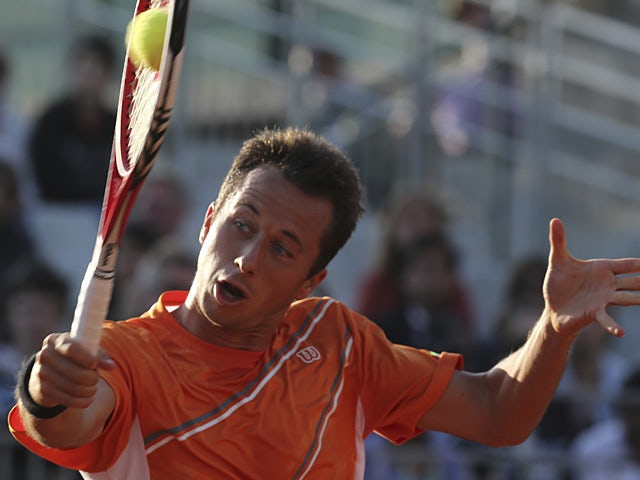 Philipp Kohlschreiber returns the ball to Victor Hanescu during their third round match on the French Open on June 1, 2013