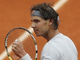 Rafael Nadal celebrates after defeating Martin Klizan during their second round match of the French Open on May 31, 2013