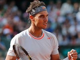 Rafael Nadal celebrates after defeating Fabio Fognini during their third round match of the French Open on June 1, 2013