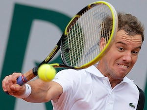 Richard Gasquet returns the ball to Michal Przysiezny during their second round match of the French Open on May 31, 2013