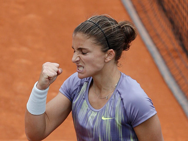 Sara Errani celebrates after defeating Sabine Lisicki during their third round match of the French Open on May 31, 2013